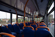 A near empty top deck of a bus on 19th March 2020 in London, United Kingdom. More people are working from home and Tranport for London are running a reduced tube and bus service in London in an effort to delay the spread of the  coronavirus.