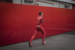 February 20, 2019 - Montmelo, Barcelona, Spain - Sebastian Vettel of Ferrari F1 Team runs away of media and fans  at the Paddock area of  the Circuit de Catalunya in Montmelo (Barcelona province) during the pre-season testing session. (Credit Image: © Jordi Boixareu/ZUMA Wire)