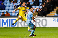 Wimbledon midfielder Andy Barcham (17) with a shot  during the EFL Sky Bet League 1 match between Coventry City and AFC Wimbledon at the Ricoh Arena, Coventry, England on 12 January 2019.