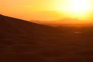 Sunset with sand dunes at Erg Chebbi, Merzouga, Morocco.