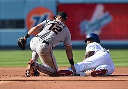 March 29, 2018 - Los Angeles, CA, U.S. - LOS ANGELES, CA - MARCH 29: Los Angeles Dodgers Right field Yasiel Puig (66) slides in successfully at second for a steal against San Francisco Giants Second base Joe Panik (12) during the MLB opening day game between the San Francisco Giants and the Los Angeles Dodgers on March 29, 2018 at Dodger Stadium in Los Angeles, CA. (Photo by Chris Williams/Icon Sportswire) (Credit Image: © Chris Williams/Icon SMI via ZUMA Press)