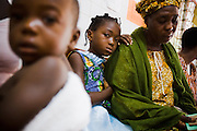 Ahoua Konante waits with her seven-year-old daughter Aishata, who suffers from fever, cough and muscle pains, at the NDA health center in Dimbokro, Cote d'Ivoire on Friday June 19, 2009.