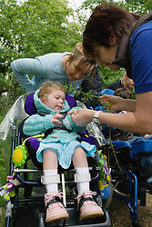 Child with cerebral palsy out on a nature walk,