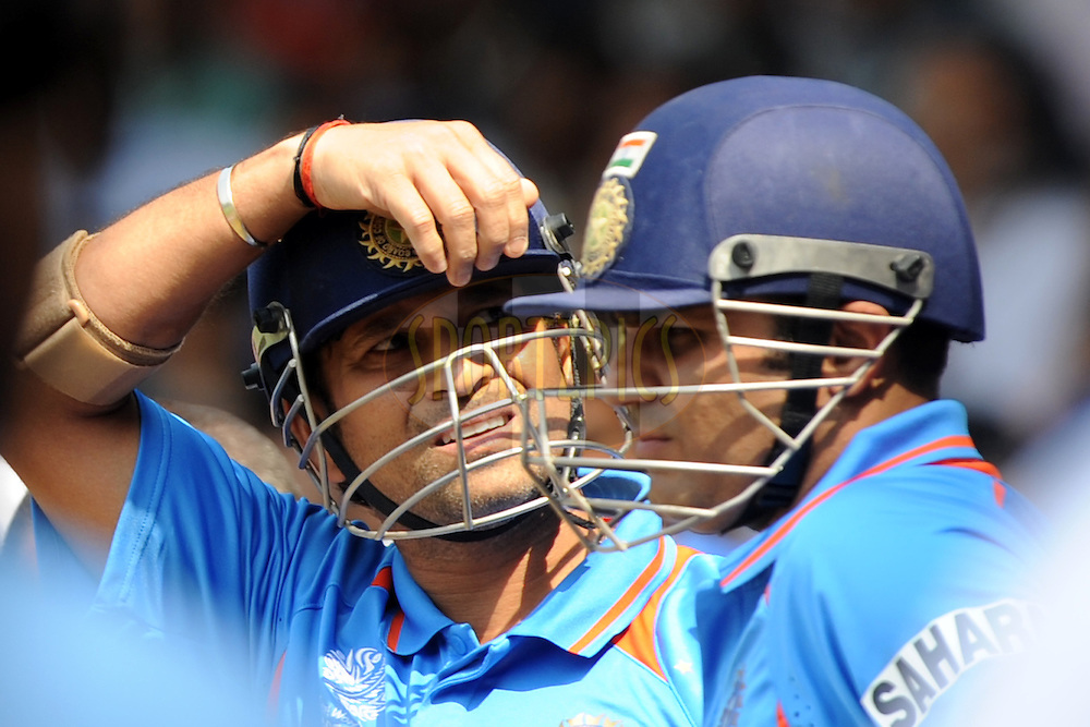 Sachin Tendulkar of India and Virender Sehwag of India wait to enter the ground to start the innings during the ICC Cricket World Cup match between India and England held at the M Chinnaswamy Stadium in Bengaluru, Bangalore, Karnataka, India on the 27th February 2011..Photo by Pal Pillai/BCCI/SPORTZPICS