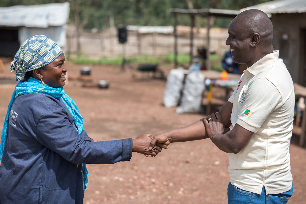 5 June 2019, Gado, Cameroon: Usman Fatou (left) acts as chairlady of the Women's Empowerment site in Gado. Here, she greets Lutheran World Federation country representative for Cameroon, Philbert Habonimana (right). Supported by the Lutheran World Federation, the Gado refugee camp in he East region of Cameroon hosts more than 25,000 refugees from neighbouring Central African Republic.