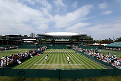 A general view of double's action on court 10 between Robin Haase and Robert Lindstedt vs. Ivan Dodig and Rajeev Ram on day three of the Wimbledon Championships at the All England Lawn Tennis and Croquet Club, Wimbledon.