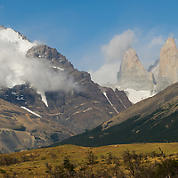 Clouds encircle Mount Almirante Nieto and the Towers of Paine in Torres del Paine National Park, Chile