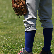 A young baseball player fielding in the outfield during the Norwalk Little League baseball competition at Broad River Fields,  Norwalk, Connecticut. USA. Photo Tim Clayton