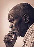 William Miko is a Zambian artist, and his father lived with him in his last years.  Photographed at William's house in Lusaka, Zambia.