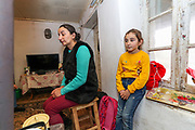 """""""He left for 35 days, he never returned"""" Gulnara Harutian, the widow of Alosha Gregorian (41) remembers when I visited her house after she invited us upon my visit at the local school in Çartar, which is about 47/km far from Stepanakert (Xankendi) in eastern Nagorno Karabakh.<br /> Alosha was reportedly killed in his position by an Azerbaijani shell the family say. """"He was a sniper shooter"""" his father Alihan remembers. Alosha was the father of three children. Two daughters and one son. From the age of 8 from his daughter (R in picture) to 12 years of his son and 15 years of age of his older daughter.<br /> <br /> Gulnara (in picture), now a widow at her late 30's (38 of age) finds it difficult to raise three children alone, with a recently half-built house by the borderline with Azerbaijani armed forces. Although her house is located within the internationally and newly recognised territory of Azerbaijan, she said she is determined to stay there adding that she's got nowhere to go, however having to pay the price of living in fear that quote: """"Azeris diversants might come in the midst of the night and slit our throats while asleep"""".<br /> Gulnara's father died, while her mother is still alive. She was married to Alosha for sixteen years. <br /> She said she's lucky that parents and family of Alosha are still supporting her. However, her emotional and mental wellbeing appears to be devastating, she also feels that she can't help her children who cannot accept that their father is no longer amongst them. She explained that is very difficult to explain this situation to her children because their father is a figure of protection and they feel unprotected now.<br /> During 44 days of the war, the region saw an end of the conflict after a ceasefire agreement was signed by the leaders of Armenia, Russia and Azerbaijan on 9 November to end the military conflict in Nagorno-Karabakh. Azerbaijani government established the Karabakh Region Authority (KRU) for the districts of """
