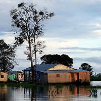 South America, Brazil, Amazon. Dwellings await rising waters of the Amazon.