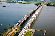 Nederland, Zuid-Holland, Hollandsch Diep, 04-07-2006;  Moerdijkbruggen gezien in de richting van Brabant; links de bestaande spoorbrug, rechts de nieuwe brug voor de HSL, deze brug is ontworpen door Benthem Crouwel..zie ook andere foto's van deze lokatie (lucht en panorama); deevan de serie Panorama Nederland.View on Moerdijk bridges southern direction. The new raibridge (r) for the HST has been designed by Benthem Crouwel,.Other aerial and panorama photos available, part of the series Panorama Nederland (major infrastucture photo project).luchtfoto (toeslag); aerial photo (additional fee required); .foto Siebe Swart / photo Siebe Swart