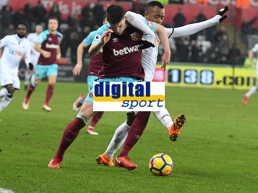Football - 2017 / 2018 Premier League - Swansea City vs. West Ham United<br /> <br /> Declan Rice of West Ham United & Jordan Ayew of Swansea City contest the ball , at the Liberty Stadium.<br /> <br /> COLORSPORT/WINSTON BYNORTH