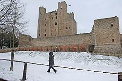 © Licensed to London News Pictures 10/02/2021.        Rochester, UK. A woman walking near Rochester Castle in Kent. Temperatures are set to drop to a freezing cold -7C in Kent and the South East tonight with more snowfall expected. Photo credit:Grant Falvey/LNP