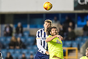 Millwall forward Harry Smith (30), Peterborough United midfielder Michael Bostwick (4) during the EFL Sky Bet League 1 match between Millwall and Peterborough United at The Den, London, England on 28 February 2017. Photo by Sebastian Frej.