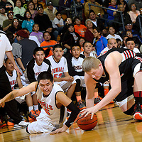 022714  Adron Gardner/Independent<br /> <br /> Gallup Bengal varsity basketball coach Dominic Romero, left, watches from the sidelines as Bengal Tyler John (45), center, and Grants Pirates Bradley Hatten (55) fight for a loose ball in the district 4A tournament at Gallup High School in Gallup Thursday