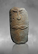 Late European Neolithic prehistoric Menhir standing stone with carvings on its face side. The representation of a stylalised male figure starts at the top with the bottom of a carving of a falling figure with head at the bottom and 2 curved arms encircling a body above. at the bottom is a carving of a dagger running horizontally across the menhir. Excavated from Piscina 'E Sali V site,  Laconi. Menhir Museum, Museo della Statuaria Prehistorica in Sardegna, Museum of Prehoistoric Sardinian Statues, Palazzo Aymerich, Laconi, Sardinia, Italy .<br /> <br /> Visit our PREHISTORIC PLACES PHOTO COLLECTIONS for more photos to download or buy as prints https://funkystock.photoshelter.com/gallery-collection/Prehistoric-Neolithic-Sites-Art-Artefacts-Pictures-Photos/C0000tfxw63zrUT4