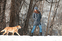 A young woman walks her dog in Jackson Hole, Wyoming.