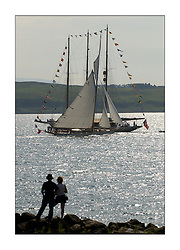 Moonbeam IV, a 105' Gaff Cutter designed primarily to race in 1914, passes the bunting of Adix a 220' Schooner anchored off Largs to close the regatta...This the largest gathering of classic yachts designed by William Fife returned to their birth place on the Clyde to participate in the 2nd Fife Regatta. 22 Yachts from around the world participated in the event which honoured the skills of Yacht Designer Wm Fife, and his yard in Fairlie, Scotland...FAO Picture Desk..Marc Turner / PFM Pictures