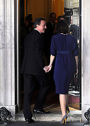 © under license to London News Pictures. LONDON. 05/05/2011. One year on since the last General Election. FILE PICTURE DATED.11/05/10. David Cameron and his wife Samantha enter Number 10 Downing Street after he became British Prime Minister. British Prime Minister Gordon Brown has resigned his position and David Cameron has become the new British Prime Minister on May 11, 2010. The Conservative and Liberal Democrats are to form a coalition government after five days of negotiation. Photo credit should read Stephen Simpson/LNP
