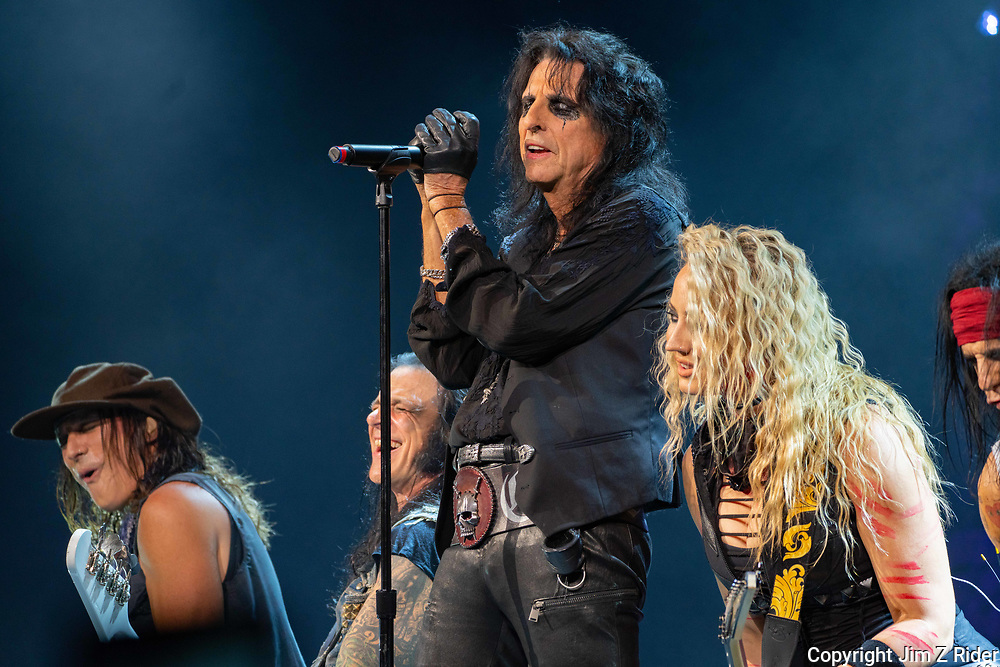 After nearly 19 months off stage, Rock and Roll legend ALICE COOPER, 73, launches his fall 2021 tour at Ocean Casino Resort in Atlantic City, New Jersey. He is joined by RYAN ROXIE, guitar, far left, base player CHUCK GARRIC, and NITA STRAUSS, vocals and guitar.