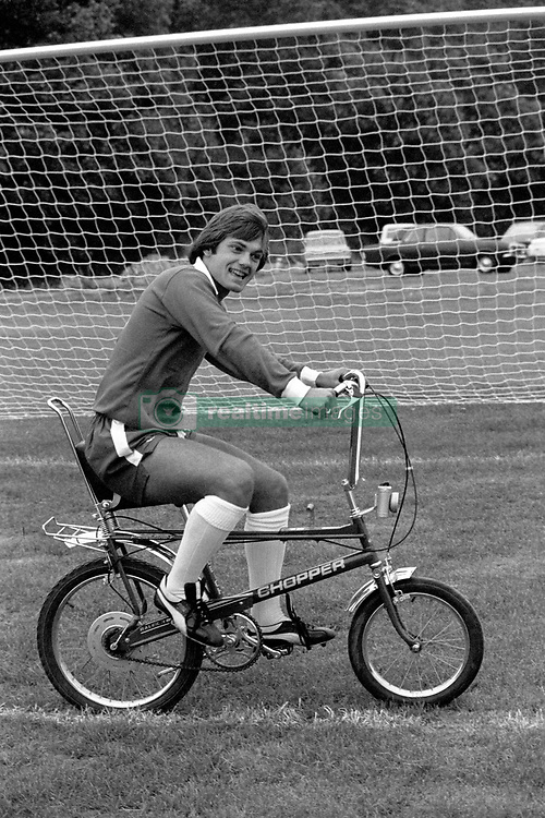 File photo dated 23-07-1975 of Chelsea FC captain Ray Wilkins, gets some leg exercise on a chopper bicycle, at the club's Morden training ground.