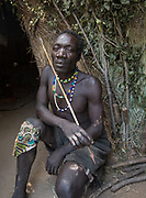 Isaya making arrows. At the Hadza camp of Senkele.