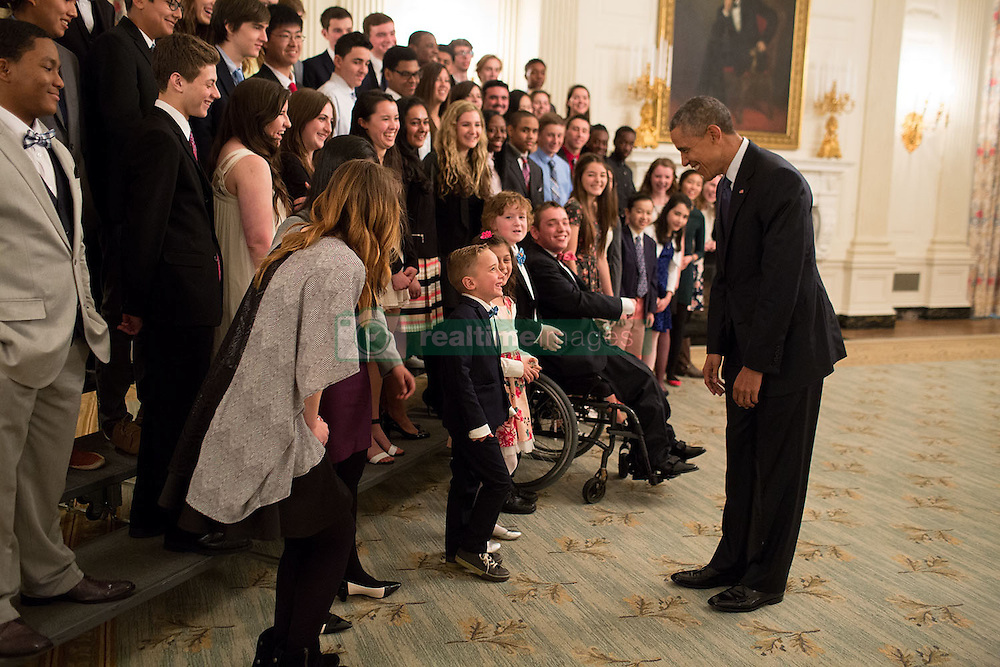 President Barack Obama interacts with a young participant as he talks with students during the White House Student Film Festival in the State Dining Room, March 20, 2015. (Official White House Photo by Pete Souza)<br /> <br /> This official White House photograph is being made available only for publication by news organizations and/or for personal use printing by the subject(s) of the photograph. The photograph may not be manipulated in any way and may not be used in commercial or political materials, advertisements, emails, products, promotions that in any way suggests approval or endorsement of the President, the First Family, or the White House.