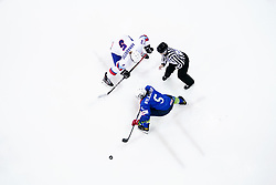 Iceland's Sigrun Arnadottir (top) and Slovenia's Arwen Nylaander battle for the puck during the Beijing 2022 Olympics Women's Pre-Qualification Round Two Group F match at the Motorpoint Arena, Nottingham.