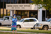 22 AUGUST 2020 - DES MOINES, IOWA: A person stands on the median of 2nd Ave in front of the main US Post Office in Des Moines during a rally in support of the USPS. About 35 people picketed the main US Post Office in Des Moines Saturday protesting changes made to the Postal Service by the Trump Administration. Nationally, there has been concern that changes to the Postal Service will hurt citizens' ability to vote by mail in the 2020 presidential election.        PHOTO BY JACK KURTZ