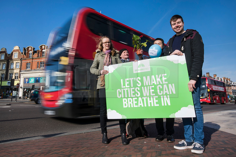 © Licensed to London News Pictures. 24/02/2018. London, UK. Green Party activists on Brixton Road, London's most polluted street, as part of their 'Breathing Cities' campaign to reverse air pollution in Britain's cities. Photo credit: Rob Pinney/LNP