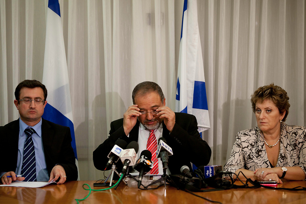 Israel's Foreign Minister Avigdor Lieberman (C), Knesset Member Faina Kirschenbaum (R) and Knesset Member Robert Ilatov (2nd L) attend a press conference at the Knesset, Israel's parliament on July 20, 2011, following a voting session over two controversial bills. One bill calls for the establishment of parliamentary inquiry committees to investigate foreign organizations and government funding of left-wing non-governmental organizations (NGOs) and human rights groups accused of anti-Israel activity, especially when it comes to land purchases on their behalf. The second bill would probe the NGOs and groups that take an active part in the delegitimization of the IDF.