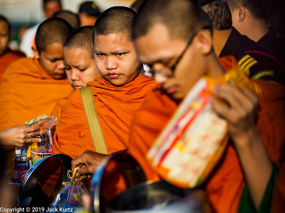 01 JANUARY 2019 - BANGKOK, THAILAND:   Buddhist novices at the New Year's merit making ceremony on the plaza in front of City Hall in Bangkok. City Hall traditionally hosts one of the largest New Year merit making ceremonies in Thailand. This year about 160 monks participated in the event.   PHOTO BY JACK KURTZ