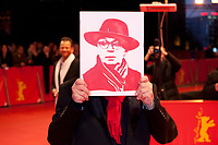 Festival Director Dieter Kosslick holds a portrait of himself presented by cinema fans at the Award Ceremony red carpet at the 69th Berlinale International Film Festival, on Saturday 16th February 2019, Berlinale Palast, Berlin, Germany.