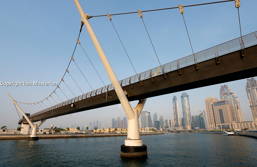 View of footbridge crossing the new Dubai Water Canal a waterway that connects into Dubai Creek and the sea. UAE, United Arab Emirates