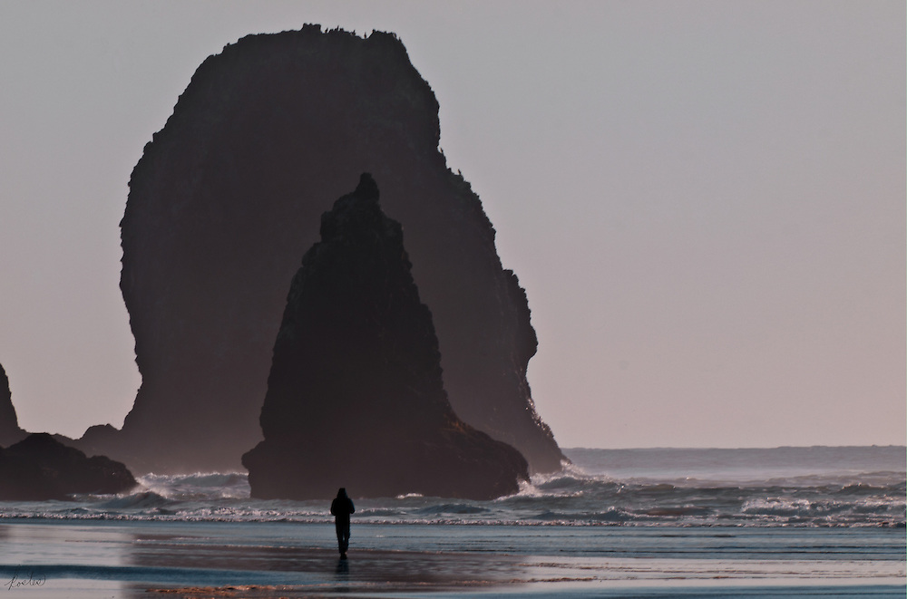 Wonderful stacks on the Oregon coast with a person lined up perfectly with the stacks, giving it all perspective. Subtle blues, pinks greys and blacks all add to the sense of mystery.
