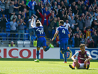 Football - 2017 / 2018 Championship - Cardiff City vs. Aston Villa<br /> <br /> <br /> Neil Taylor of Aston Villa sits on the pitch, looking despondent as Nathaniel Mendez-Laing of Cardiff City celebrates scoring his team's first goal, at Cardiff City Stadium<br /> <br /> COLORSPORT/WINSTON BYNORTH