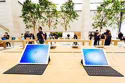 © Licensed to London News Pictures. 13/10/2016. iPads on display at the new Apple store in Regent Street is unveiled at a press preview with a new exterior and interior design concept by Foster + Partners.  Regent St was the first Apple store in Europe and has served over 60 million customers over the past 12 years. London, UK. Photo credit: Ray Tang/LNP