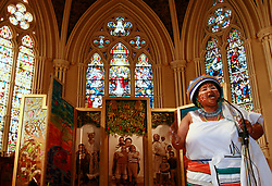 Aug 13, 2006; Toronto, ON, Canada; The Keiskamma Altarpiece was unveiled tonight at St. James Cathedral. Measuring 6.5 meters wide by 4 meters high, the formidable piece was created by over 120 women and men from the Eastern Cape of South Africa - one of the areas of Africa hardest hit by HIV/AIDS - and is athree part, beaded, quilted, and photographic homage to the loved ones they have lost to the disease. ''The Keiskamma Altarpiece acknowledges the profoundly painful impact of the AIDS epidemic on the community while celebrating the response of its members, especially the women, in caring for those inneed,'' says Dr. Carol Hofmeyr, director of the Keiskamma Trust. Dr. Hofmeyr was there along with one of the grandmothers featured in the piece, Eunice Mangwane - who is looking after a grandson with AIDS. Pictured: Eunice Mangwane sings for the congregation. She is the grandmother in the centre panel, holding onto the children. Mandatory Credit: Photo by Tory Zimmerman/Toronto Star/ZUMA Press. (©) Copyright 2006 by Toronto Star