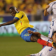 Enner Valencia, Ecuador, moves in to score his second goal as he shoots past Alexander Mendoza, during the Ecuador Vs El Salvador friendly international football match at Red Bull Arena, Harrison, New Jersey. USA. 14th October 2014. Photo Tim Clayton