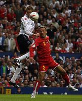 Photo: Paul Thomas.<br /> England v Macedonia. UEFA European Championships 2008 Qualifying. 07/10/2006.<br /> <br /> Peter Crouch (L) of England beats Nikolce Noveski in the air.