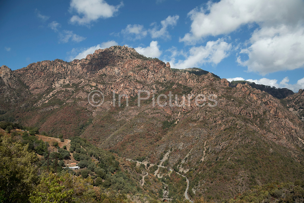 Mountain landscape view in the area near to Ota called the Gorges de Spelunca on 11th September 2017 in Corsica, France. Corsica is an island in the Mediterranean and one of the 18 regions of France. It is located southeast of the French mainland and west of the Italian Peninsula.