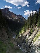 The Middle Fork of the Cimmaron River cuts a small canyon beneath Precipice Peak, Uncompahgre Wilderness, San Juan Mountains, Colorado.