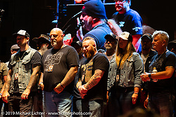 Harley-Davidson's Todd Robinson (Thor) and Stacy Blasel with the Wounded Warrior tribute on the main stage on Jackyl night at the Full Throttle Saloon during the Sturgis Black Hills Motorcycle Rally. SD, USA. Thursday, August 8, 2019. Photography ©2019 Michael Lichter.