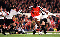 Kanu (Arsenal) Serhii Popov, Anatoliy Tymoshchuk and Dainius Gleveckas (FC Shakhar Donetsk). Arsenal 3:2 FC Shakhar Donetsk, UEFA Champions League, Group B, 20/9/2000. Credit Colorsport / Stuart MacFarlane.