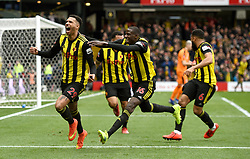 Watford's Etienne Capoue (left) celebrates scoring his sides first goal of the game with teammates
