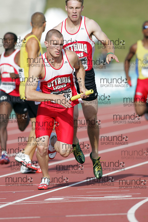 (Sherbrooke, Canada---23 July 2006) Dan Moreland to Todd Pyper in the 4x400m relay at  the 2006 Canadian Junior Track and Field Championships and national multi-events championships 21-23 July 2006 held in Sherbrooke Quebec. Copyright 2006 Sean Burges / Mundo Sport Images, www.mundosportimages.com