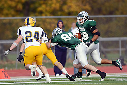 12 November 2011:  Mike Sloboda creates a little running room for Sean Conley during an NCAA division 3 football game between the Augustana Vikings and the Illinois Wesleyan Titans in Tucci Stadium on Wilder Field, Bloomington IL