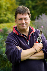 Alan Titchmarsh holding pair of secateurs