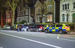 **Incident reported to be connected with the death of Multi-millionaire hotelier Sir Richard Sutton in Dorset**<br /> © Licensed to London News Pictures. 08/04/2021. London, UK. Police on Chiswick High Road following a incident in which a vehicle was stopped at approximately 22:30hrs on Wednesday 07/04/2021 when police approached the vehicle, officers discovered the lone male occupant had sustained a number of serious self-inflicted injuries. First aid was commenced immediately and the London Ambulance Service were called. The male has been taken to a west London hospital. Photo credit: Peter Manning/LNP